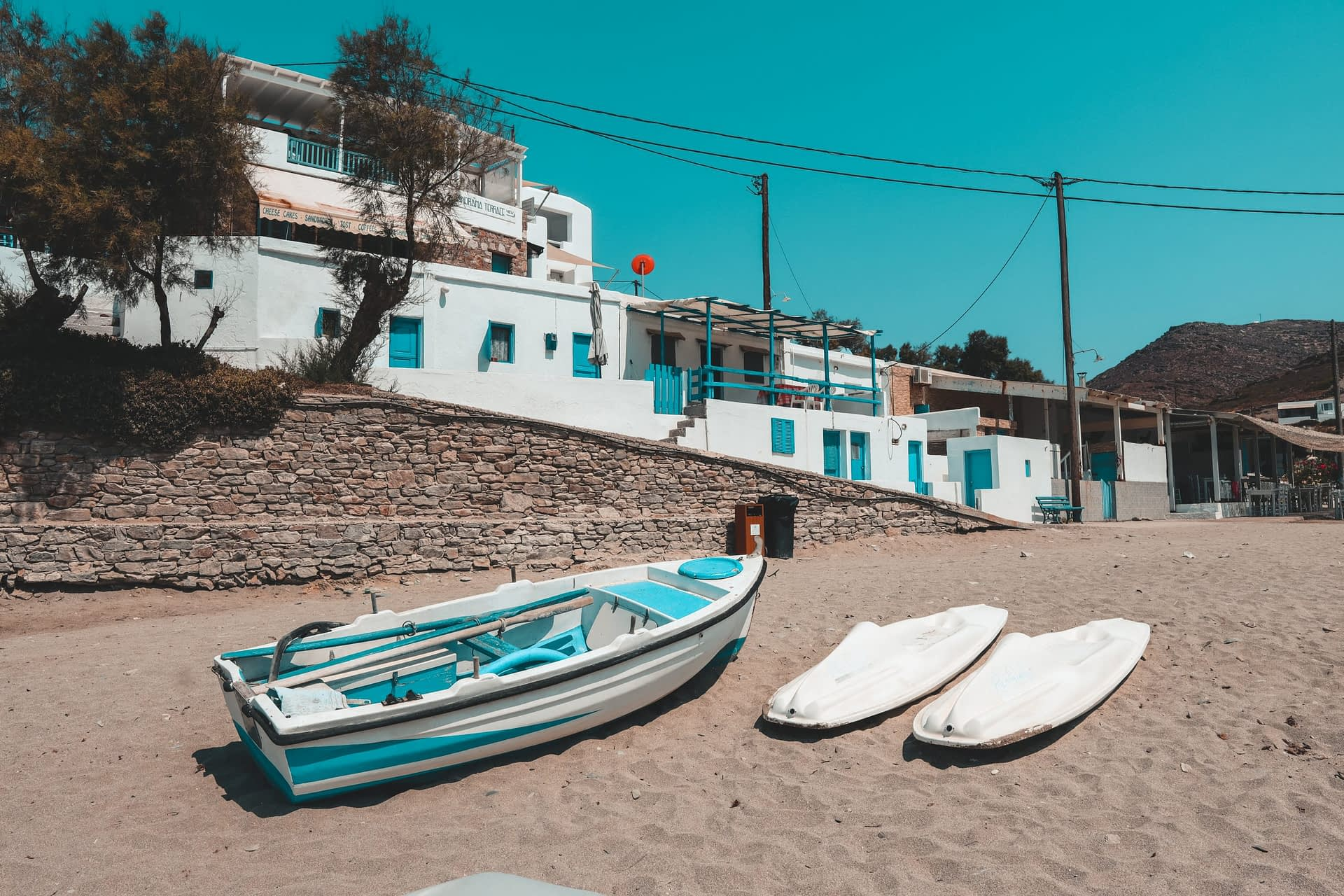Folegandros boats on a beach. What to do in Folegandros