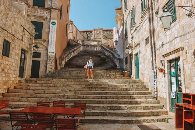 A woman stood on the spanish looking steps in Dubrovnik. What to do in Dubrovnik