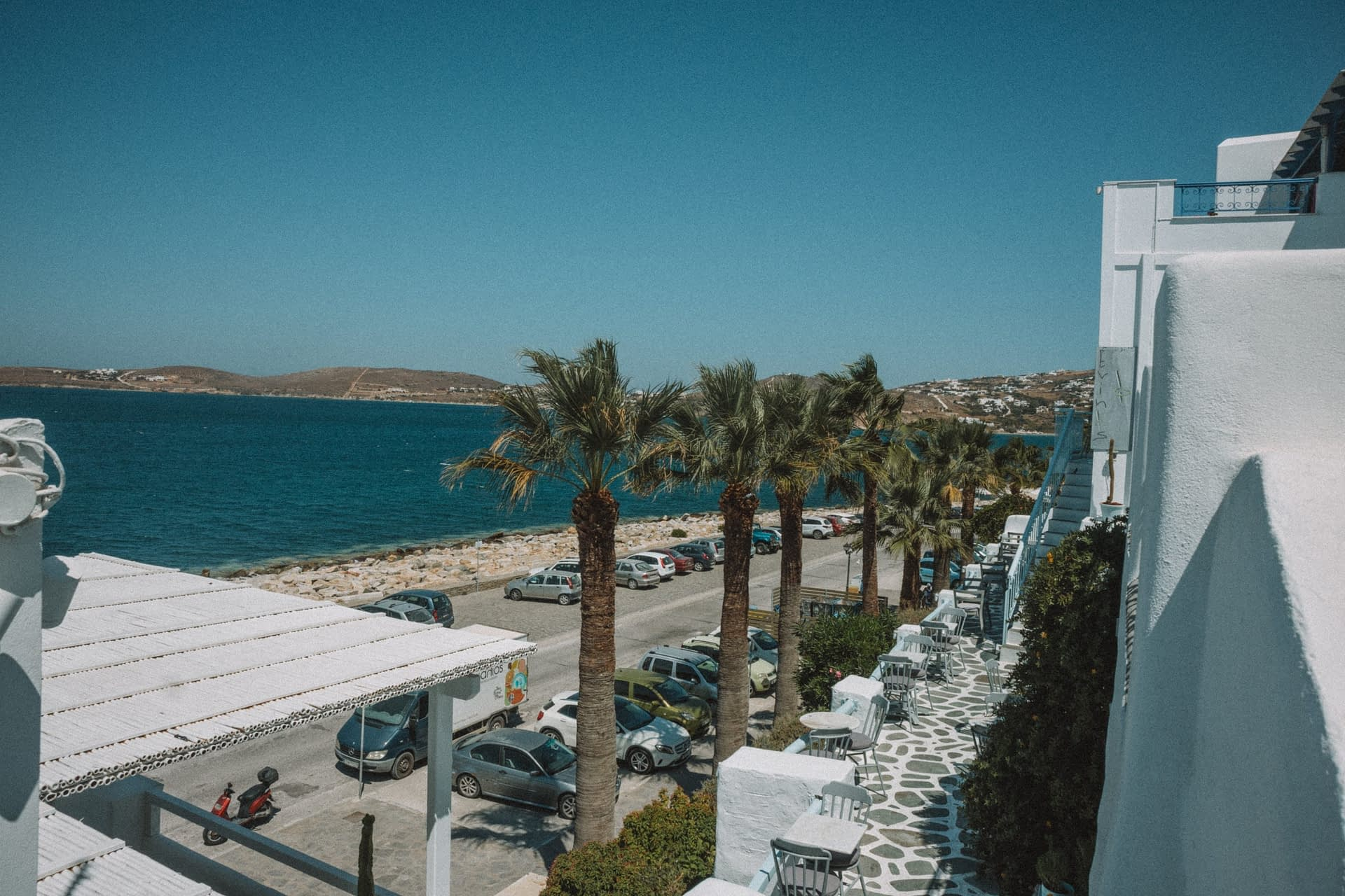 Palm trees along a beach front in Parakia. Things to do in Paros