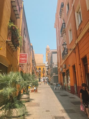 A side street in Cagliari with colourful buildings. Things to do in Cagliari