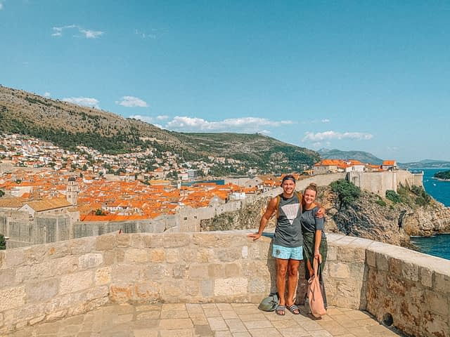 A couple on Lovrijenac fort with the old town in the background