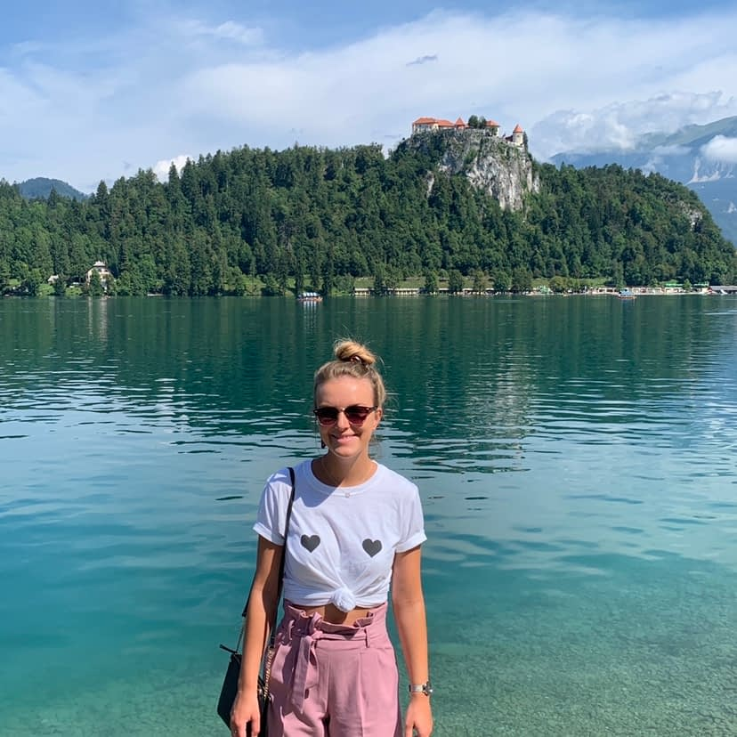 A woman in front of Lake Bled.