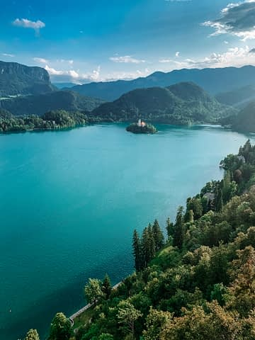 A view of Lake Bled from the castle with the lake, island and church in the middle. Things to do in Lake Bled