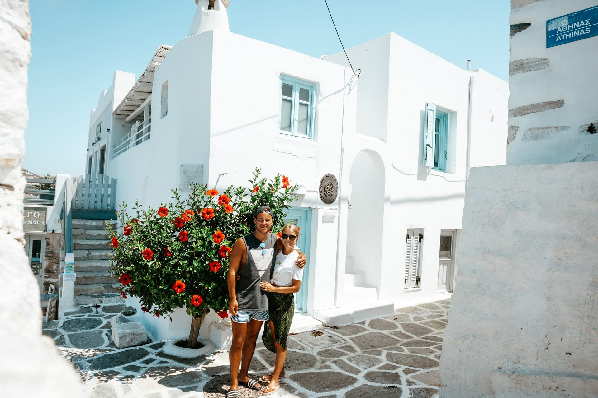 A couple stood in the alleyway of Parakia, Paros. Things to see in Paros