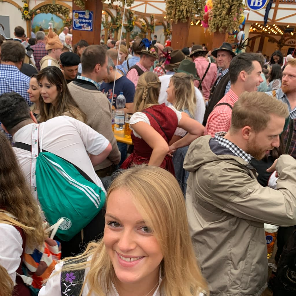 A woman with a beer in a tent at Oktoberfest