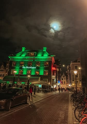 Moonlight on the Grasshopper pub in Amsterdam, Netherlands.