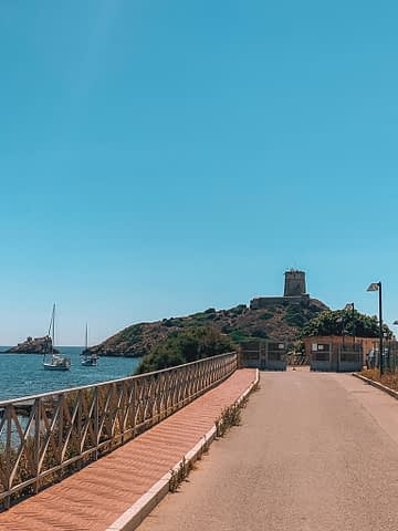 Nora castle nearby with the ocean next to it. Where to go in Sardinia