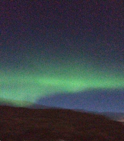 Green northern lights in the sky. Things to do in Iceland