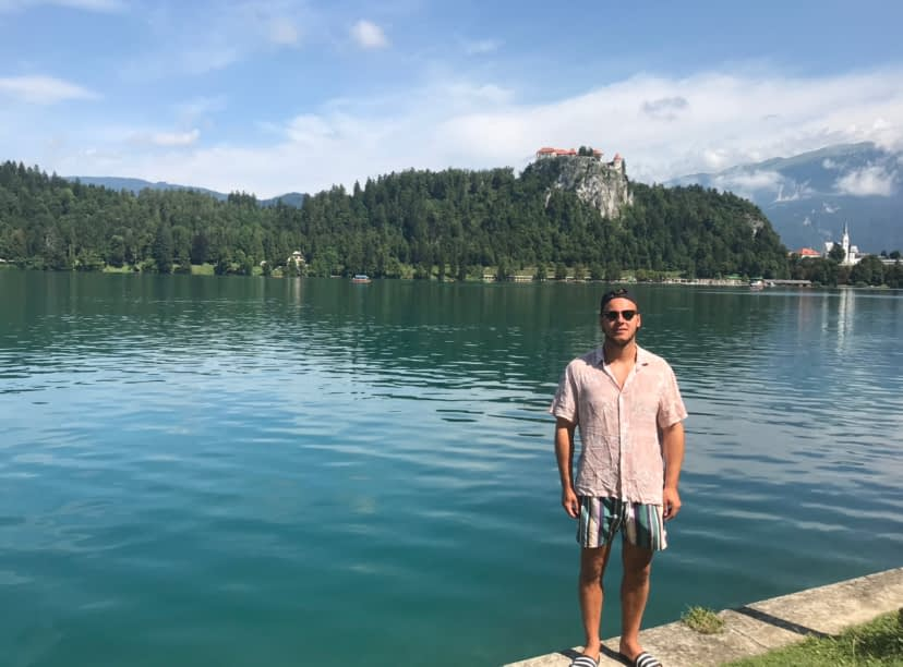 Man in front of Lake Bled as part of the things to do at Lake Bled.