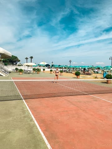 A woman playing tennis in Lido di Jesolo