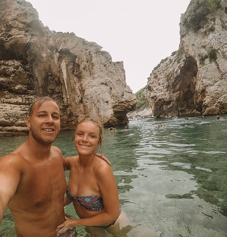 A couple taking a selfie in the sea water in Vis. Where to go in Hvar