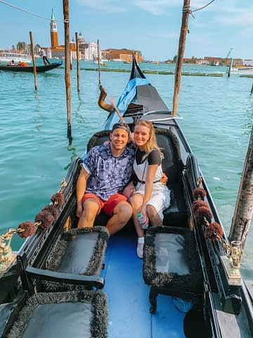 A couple taking a selfie in a gondola for a day in Venice