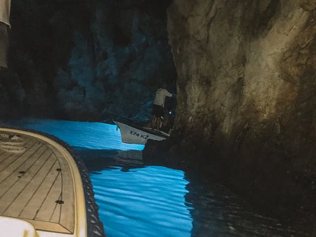 Two boats going around a cave. Things to do in Hvar