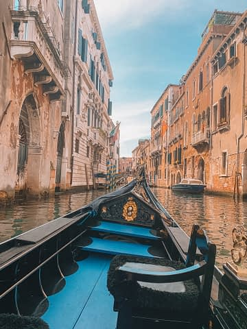 A gondola in between buildings for seeing Venice in a day