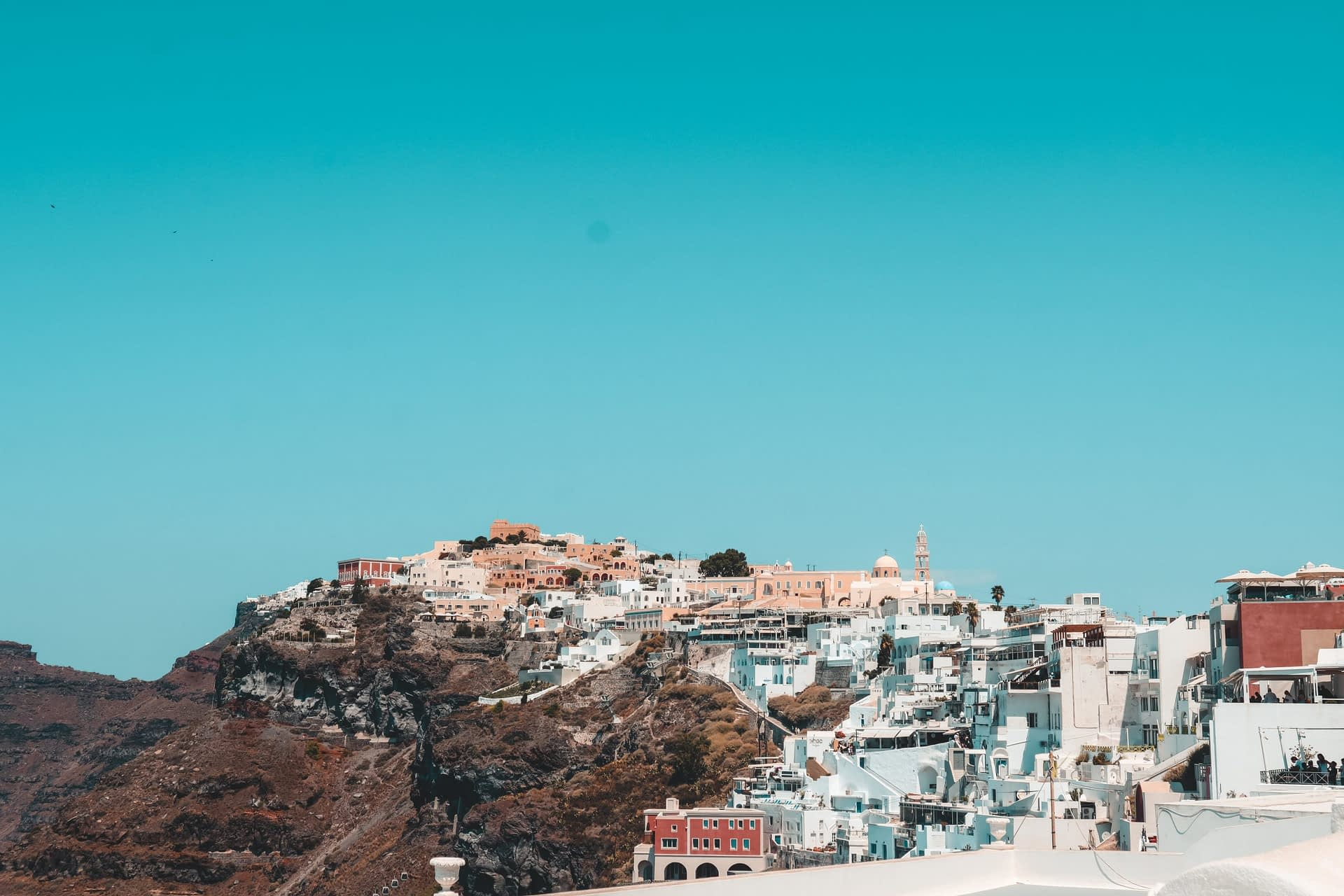 A view of the pastel buildings in Thira