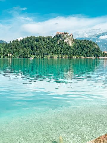 Turquoise water at Lake Bled with the castle in the background. Things to do at Lake Bled