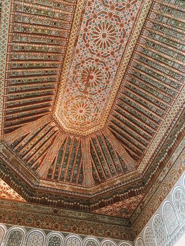 Different patterns on the ceiling of Bahia Palace. Part of the things to do in Morocco