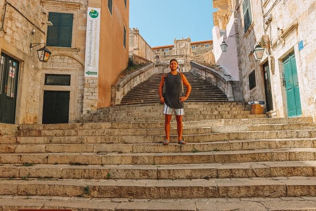 A man stood on the Jesuit steps in Dubrovnik old town