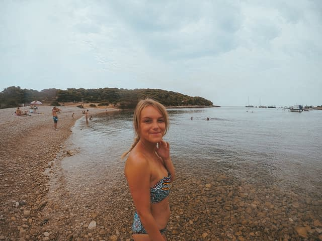 A woman on the pebble beach at Vis. Things to do in Hvar