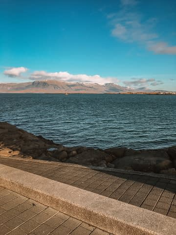 The ocean with mountains in the background in Reykjavik, Iceland