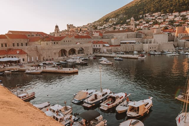 Boats in the sea by Dubrovnik harbour.
