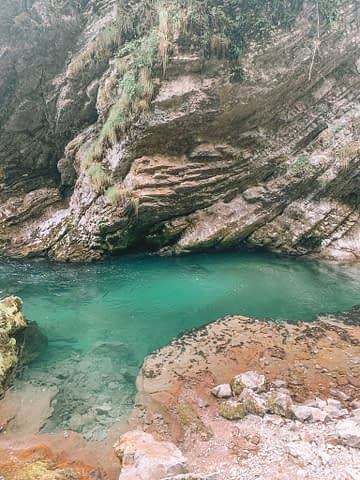 Eroding rock with green looking water at Vintgar gorge. Things to do at Lake Bled