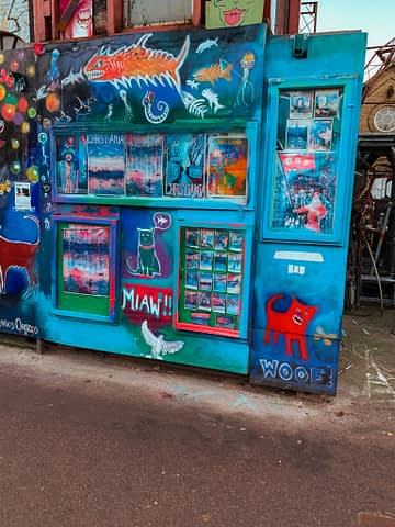 Grafitti shapes and animals on a board. Things to do in Copenhagen.