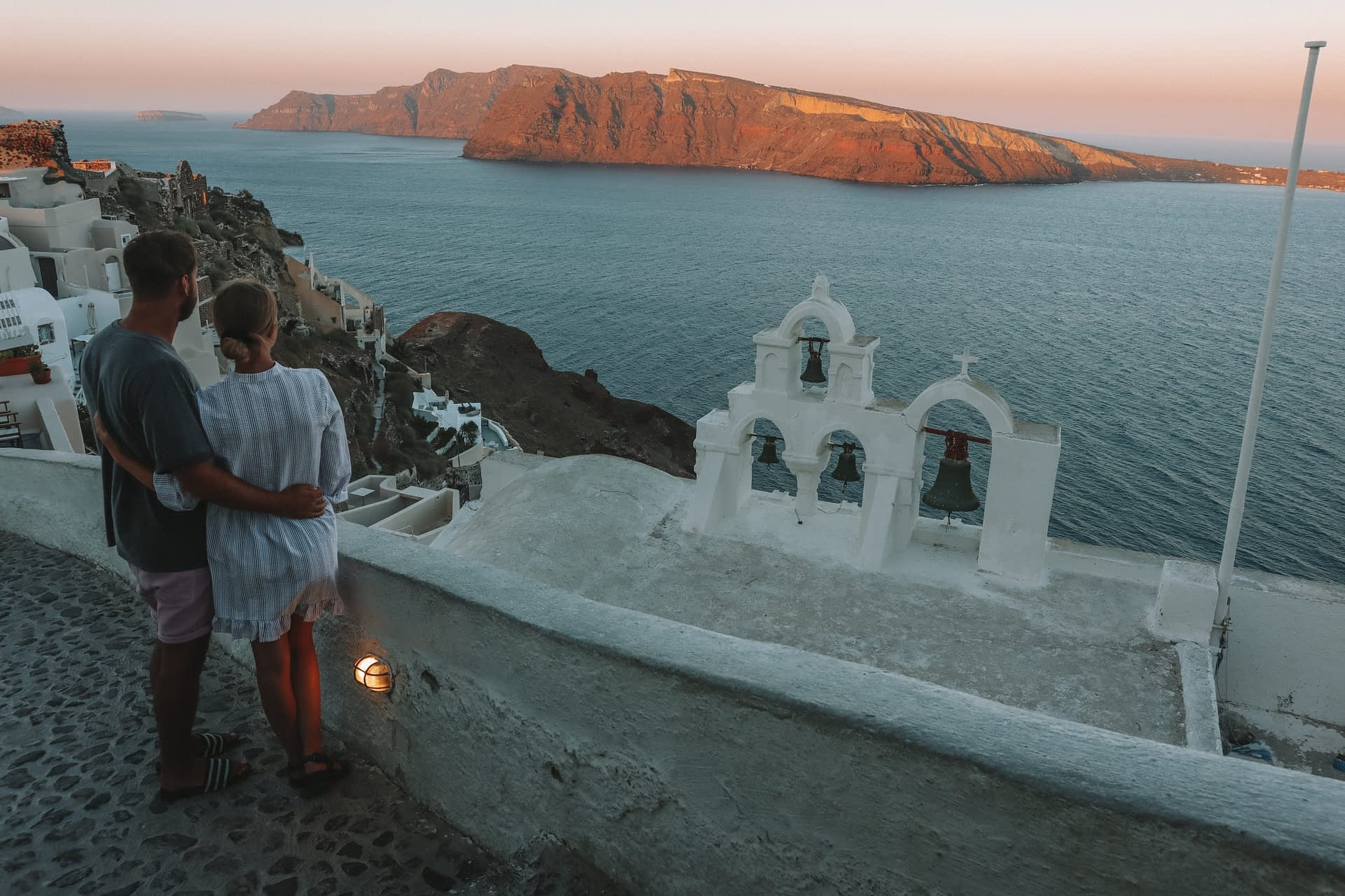 Santorini church bells with a view of nearby islands