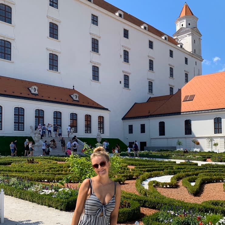 A woman in the gardens next to Bratislava castle.