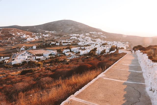 A view of the steps that lead to Panagia with whitewashed buildings in the background. What to do in Folegandros