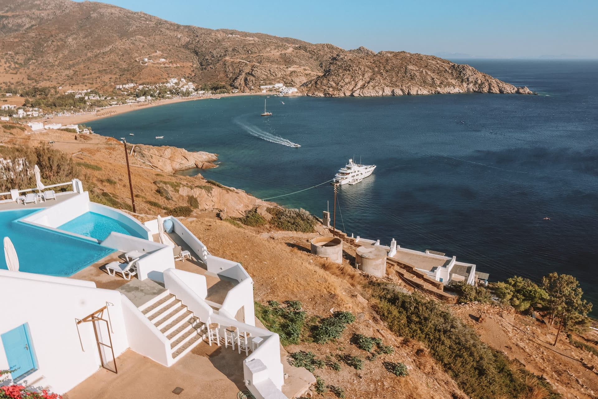View of Mylopotas from Petradi hotel during the day. Where to stay in Ios