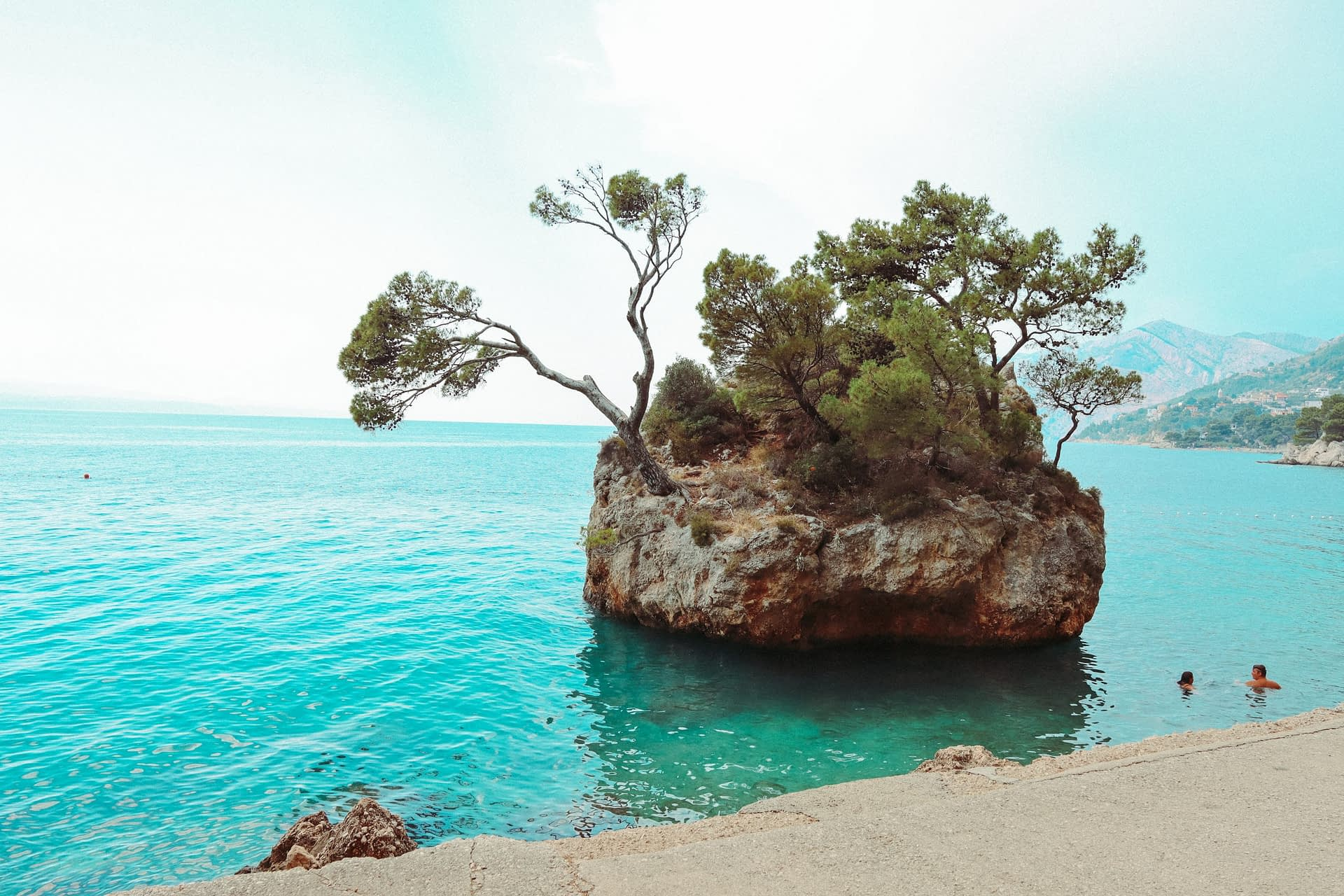 A small island in the ocean with pine trees on it. Your guide to Brela